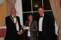 President of Swansea Rotary Club, Andrew Bellamy donates a cheque for £750